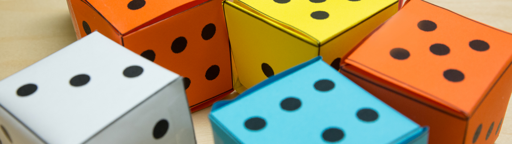 Grouping of big paper dice in different colors